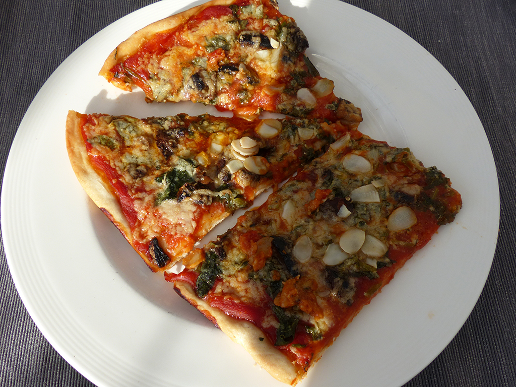 Pizza with mushrooms and kale
